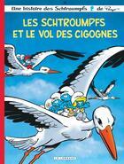 Couverture du livre « Les Schtroumpfs T.38 ; les Schtroumpfs et le vol des cigognes » de Peyo aux éditions Lombard