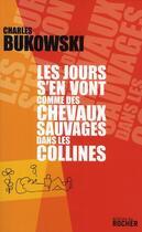 Couverture du livre « Les jours s'en vont comme des chevaux sauvages dans les collines » de Charles Bukowski aux éditions Rocher