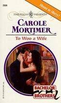 Couverture du livre « To woo a wife » de Carole Mortimer aux éditions Harlequin K.k./softbank Creative Corp.
