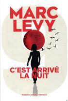 Couverture du livre « C'est arrivé la nuit » de Marc Levy aux éditions Robert Laffont