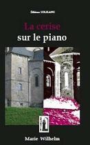 Couverture du livre « La cerise sur le piano » de Marie Wilhelm aux éditions Solilang