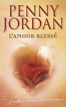 Couverture du livre « L'amour blessé » de Penny Jordan aux éditions Harlequin